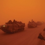 A severe sandstorm blankets a convoy from the Headquarters Battalion of the 1st Marine Division north of the Euphrates River in Iraq.